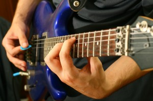 Using a guitar pick